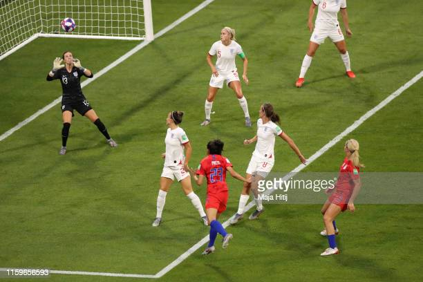 Christen Press of the USA scores her team's first goal past Carly Telford of England during the 2019 FIFA Women's World Cup France Semi Final match...