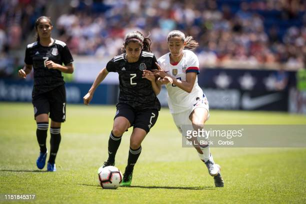 Christen Press of United States battles for control against Kenti Robles of Mexico during the International Friendly match the US Women's National...