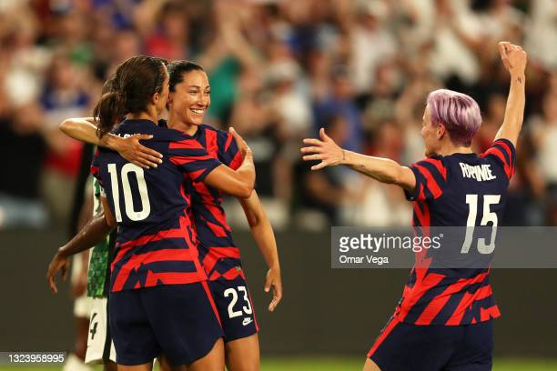 Christen Press of United States celebrates with teammates Carli Lloyd and Megan Rapinoe after scoring the first goal of her team during the Summer...