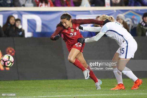 Christen Press of United States is challenged by Laura Bassett of England during the USA Vs England SheBelieves Cup match at Red Bull Arena on March...