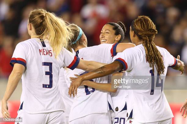 Christen Press of USA celebrates with her team mates after scoring 3rd goal during the Group A game between the United States and Costa Rica as part...