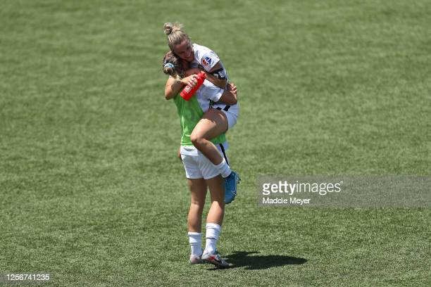 Christen Westphal and Autumn Smithers of Portland Thorns FC celebrate after defeating the North Carolina Courage in the quarterfinal match of the...