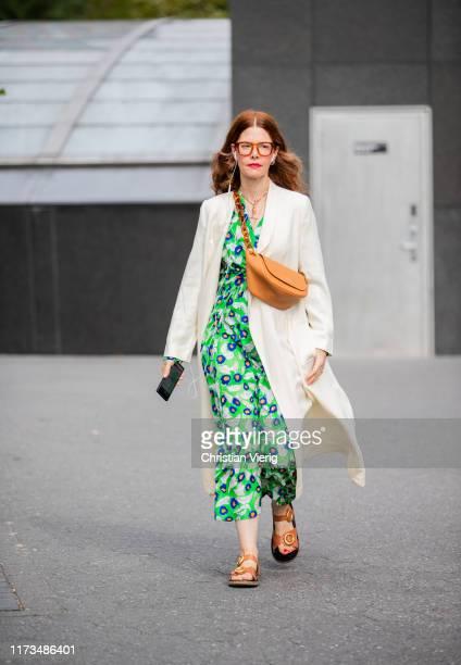 Christene Barbarich is seen wearing green dress floral print outside Carolina Herrera during New York Fashion Week September 2019 on September 09...