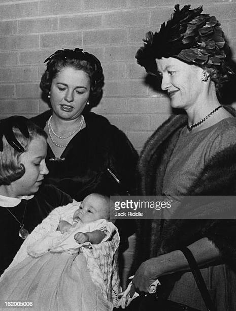 Christening of Sarah; Tiny Sarah Watkins Kelly, daughter of the Harry Kellys Jr., is surrounded by an admiring trio of godmothers Anne Holmes, Mrs....