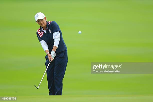 Christi Kerr of the United States Team chips the ball at the first green during the Sundays single matches in the 2015 Solheim Cup at St LeonRot Golf...