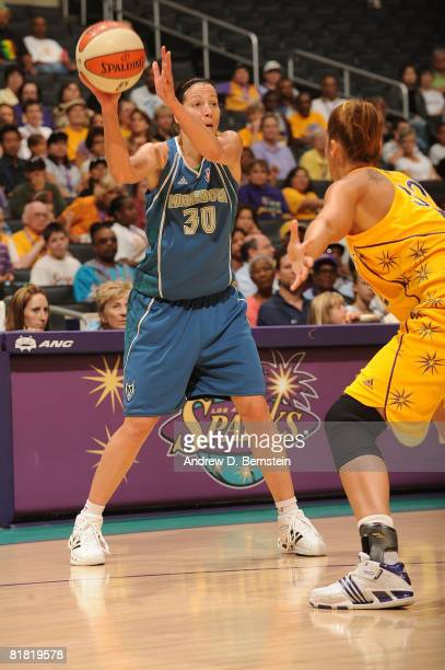 Christi Thomas of the Los Angeles Sparks guards against Anna DeForge of the Minnesota Lynx during the game on July 3 2008 at Staples Center in Los...