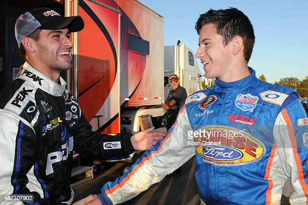 Christia PaHud driver of the PEAK Toyota shakes hands with James Bickford driver of the Sunrise Ford/Interstate Plastics/Lucas Oil Ford before the...