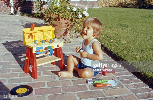 Christiaan Barnard's son Frederick playing at the terrace in Cape Town South Africa 1974