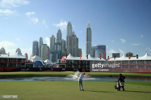 Christiaan Bezuidenhout of South Africa plays his fourth shot on the 18th hole during the final round of the Omega Dubai Desert Classic on the Majlis...