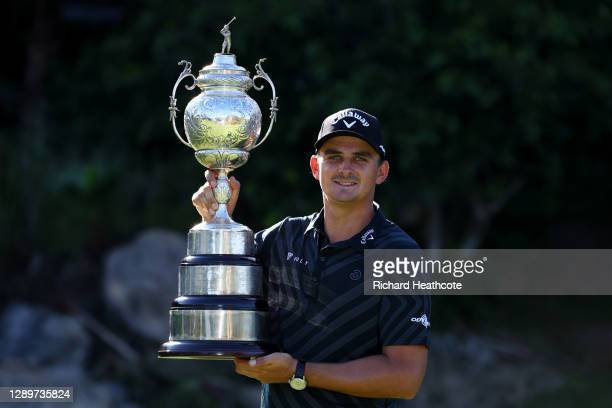 Christiaan Bezuidenhout of South Africa poses with the trophy after his victory during the final round of the South African Open at Gary Player CC on...