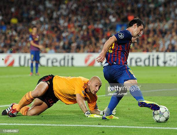 Christian Abbiati of AC Milan fails to stop Lionel Messi of FC Barcelona during the UEFA Champions League group H match between FC Barcelona and AC...