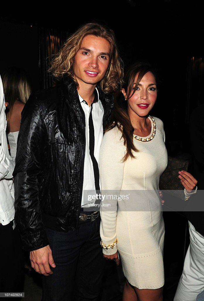 Christian Acosta And Natasha Zakai Attend The Grand