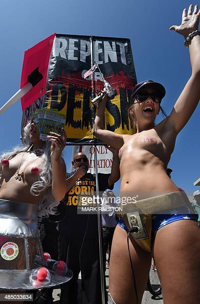 Christian activists attempt to disrupt GoTopless Day protesters during their annual protest for women's rights in Venice Beach California on August...