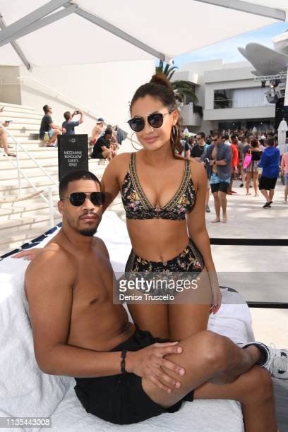 Christian Adkins and Francia Raisa attend Palms Casino Resort's KAOS Dayclub for grand opening weekend on April 6 2019 in Las Vegas Nevada