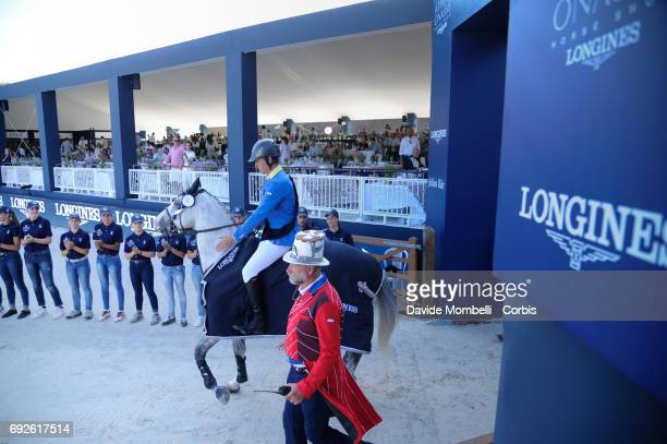 Christian Ahlmann of Germany riding Caribis Z during the prize giving ceremony for the Longines Grand Prix Athina Onassis Horse Show on June 3 2017...
