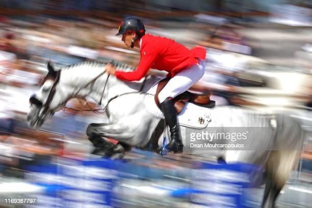 Christian Ahlmann of Germany riding Clintrexo Z competes during Day 3 of the Longines FEI Jumping European Championship, speed competition against...