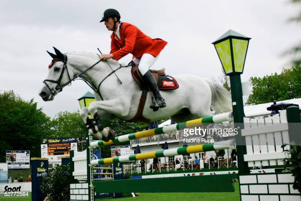 Christian Ahlmann of Germany takes a jumps on his horse Coester during the Hasseroeder Championship of Hamburg of the German Jumping and Dressage...