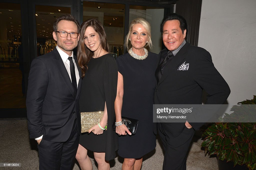 Christian and Brittany Slater with Kathleen McCrone Newton and Wayne Newton attends Destination Fashion 2016 to benefit The Buoniconti Fund to Cure Paralysis, the fundraising arm of The Miami Project to Cure Paralysis at Bal Harbour Shops on March 5, 2016 in Miami, Florida.