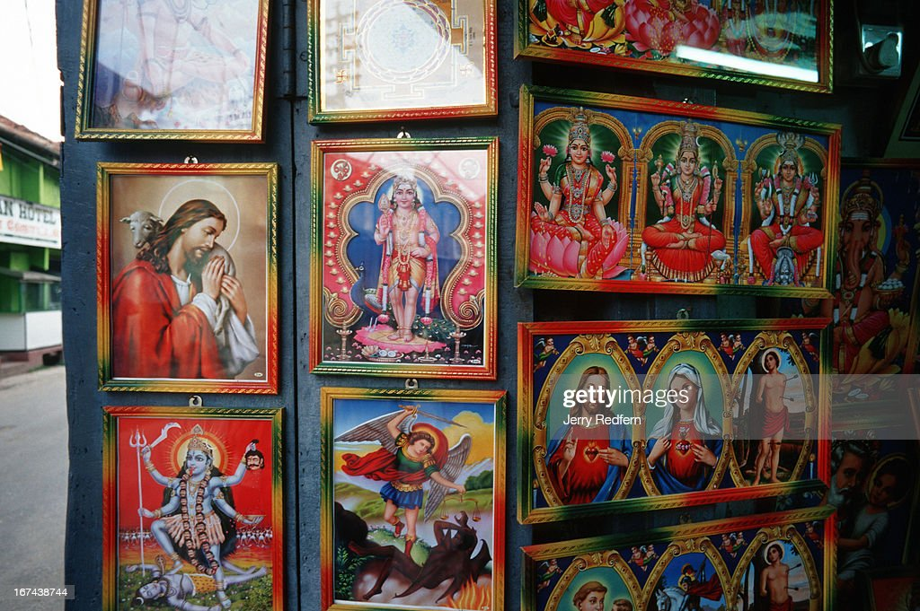 Christian and Hindu icon pictures are displayed side by side in a shop in Jaffna. The Northern Province, while predominantly Hindu, also has a large Christian population..