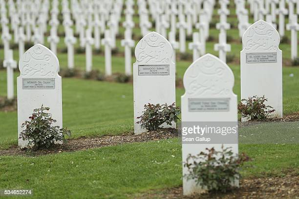 Christian and Muslim markers stand at the graves of French and French colonial soldiers killed in the World War I Battle of Verdun at the ossuary of...
