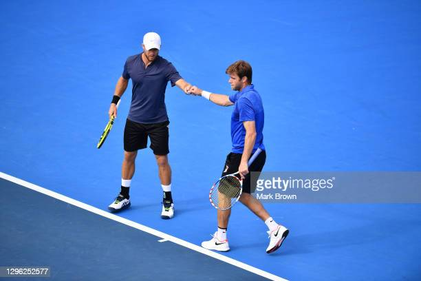 Christian and Ryan Harrison fist bump after scoring a point against Ariel Behar of Uruguay and Gonzalo Escobar of Ecuador during the Doubles Finals...