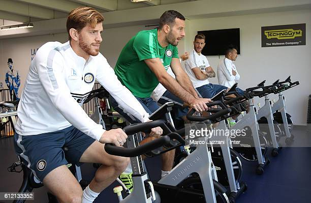 Christian Ansaldi and Samir Handanovic of FC Internazionale Milano train in the gym during the FC Internazionale training session at the club's...
