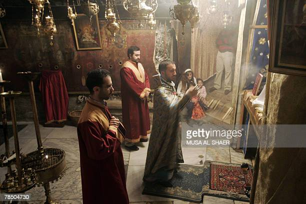 Christian Armenian priests pray in the Grotto at the Church of the Nativity the alleged birth place of Jesus Christ in the West Bank town of...