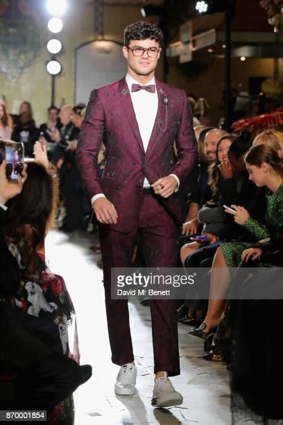 Christian Arno walks the Dolce Gabbana Italian Christmas catwalk show at Harrods on November 2 2017 in London England