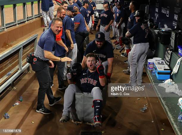 Christian Arroyo of the Boston Red Sox celebrates as he is pushed in a clothing cart after hitting a grand slam in the seventh inning against the...