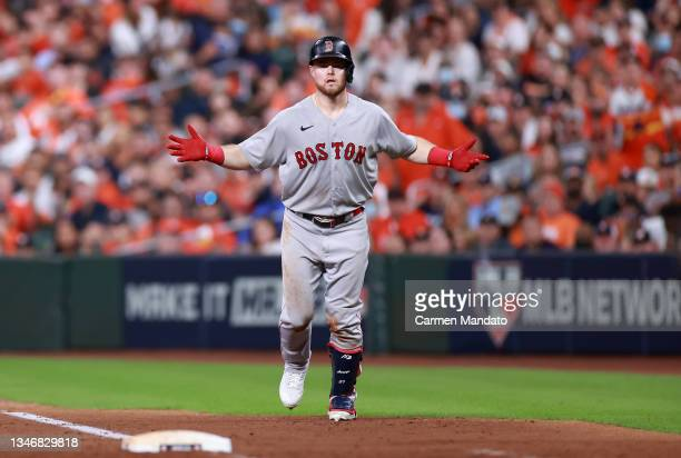 Christian Arroyo of the Boston Red Sox questions being called out after a bunt attempt in the sixth inning against the Houston Astros during Game One...