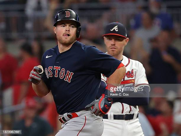 Christian Arroyo of the Boston Red Sox reacts after hitting a grand slam in the seventh inning against the Atlanta Braves at Truist Park on June 16,...