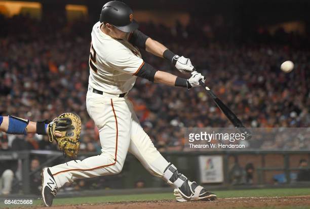 Christian Arroyo of the San Francisco Giants bats against the Los Angeles Dodgers in the bottom of the fourth inning at ATT Park on May 15 2017 in...