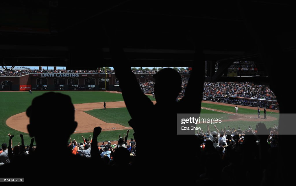 Christian Arroyo #22 of the San Francisco Giants hits a single that scored Brandon Belt #9 in the seventh inning of their game against the Los Angeles Dodgers at AT&T Park on April 27, 2017 in San Francisco, California.