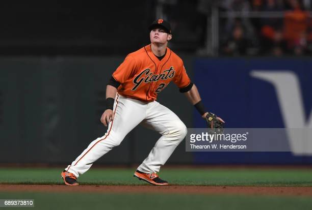 Christian Arroyo of the San Francisco Giants reacts to a ball hit by Ender Inciarte of the Atlanta Braves in the top of the seventh inning at ATT...