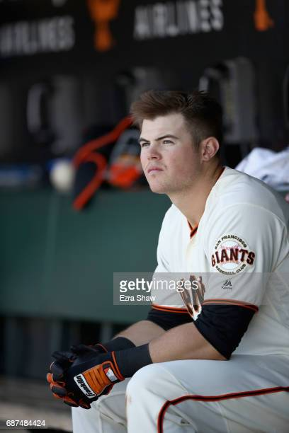 Christian Arroyo of the San Francisco Giants sits in the dugout during their game against the Los Angeles Dodgers at ATT Park on May 17 2017 in San...