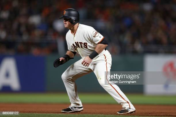 Christian Arroyo of the San Fransisco Giants leads from from first base in the seventh inning against the Los Angeles Dodgers at ATT Park on May 16...