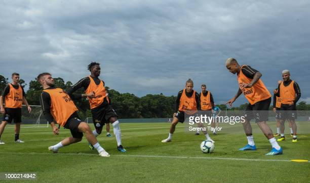 Christian Atsu and Dwight Gayle are in the middle during a game of possession also seen from LR Ciaran Clark Adam Armstrong Florian Lejeune Kenedy...