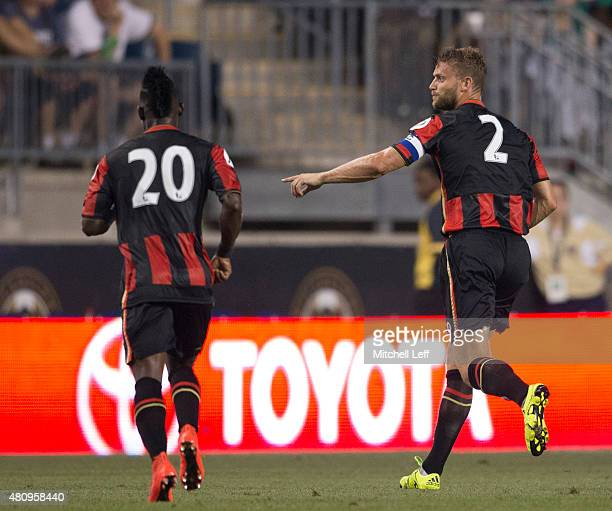 Christian Atsu and Simon Francis of AFC Bournemouth play in the friendly match against the Philadelphia Union on July 14 2015 at the PPL Park in...
