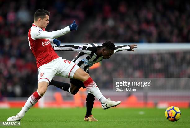 Christian Atsu of Newcastle United and Granit Xhaka of Arsenal battle for posession during the Premier League match between Arsenal and Newcastle...