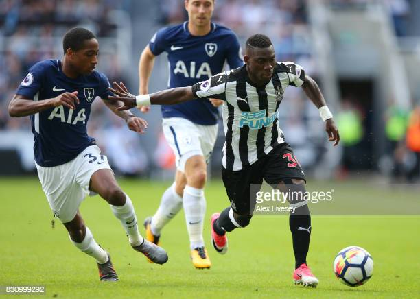 Christian Atsu of Newcastle United and Kyle WalkerPeters of Tottenham Hotspur battle for possession during the Premier League match between Newcastle...