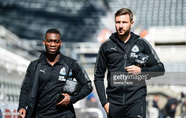 Christian Atsu of Newcastle United and Paul Dummett arrives for the Premier League Match between Newcastle United and Tottenham Hotspur at StJames'...