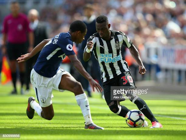 Christian Atsu of Newcastle United attempts to get past Kyle WalkerPeters of Tottenham Hotspur during the Premier League match between Newcastle...