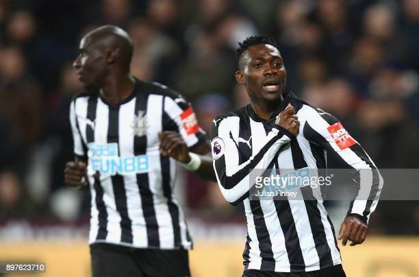 Christian Atsu of Newcastle United celebrates after scoring his sides third goal during the Premier League match between West Ham United and...