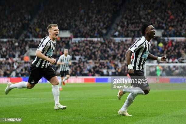 Christian Atsu of Newcastle United celebrates after scoring his team's first goal during the Premier League match between Newcastle United and...