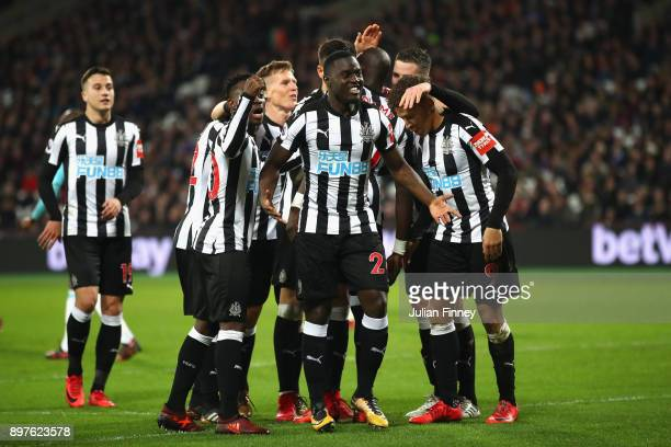 Christian Atsu of Newcastle United celebrates with team mates after scoring his sides third goal during the Premier League match between West Ham...