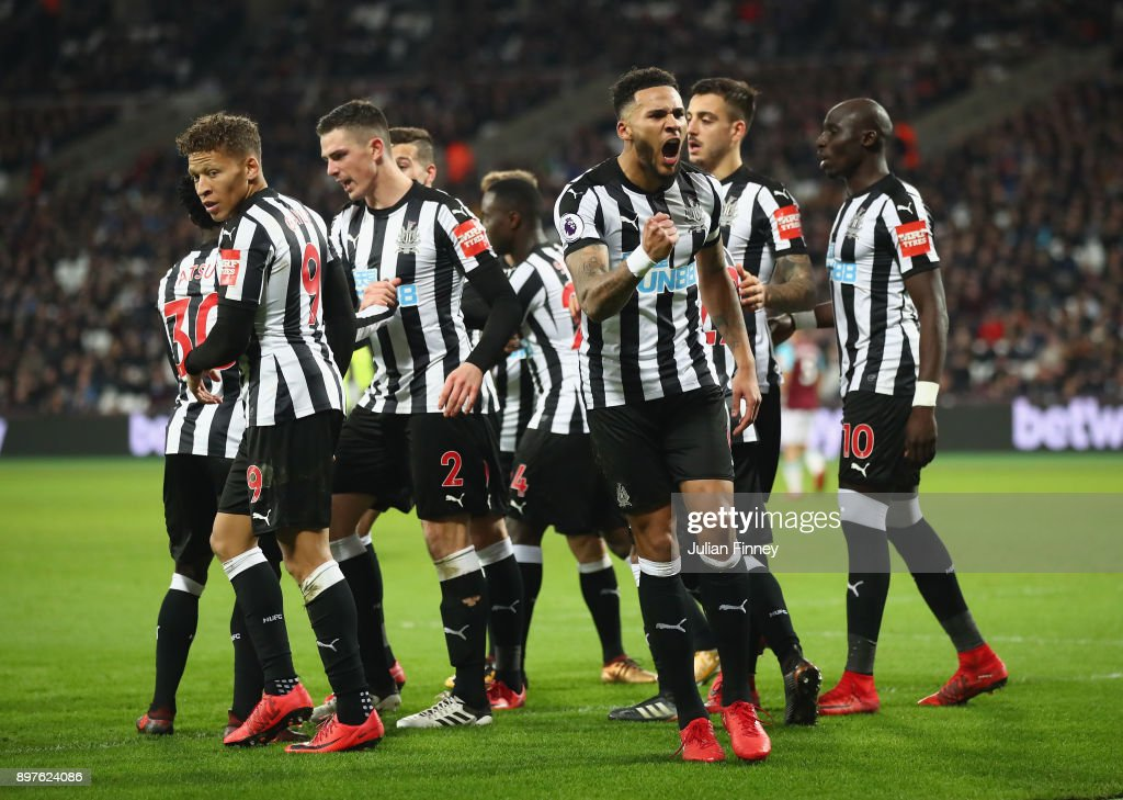 Christian Atsu of Newcastle United celebrates with team mates after scoring his sides third goal during the Premier League match between West Ham United and Newcastle United at London Stadium on December 23, 2017 in London, England.