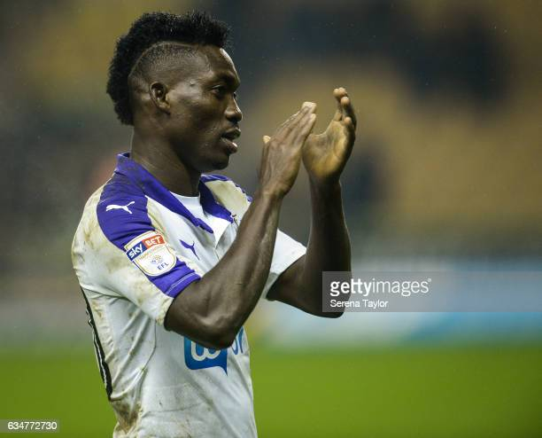 Christian Atsu of Newcastle United claps the fans after Newcastle win the Sky Bet Championship match between Wolverhampton Wanderers and Newcastle...
