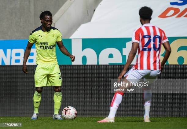 Christian Atsu of Newcastle United FC controls the ball as Tashan OakleyBoothe of Stoke City defends during the Pre Season Friendly between Newcastle...