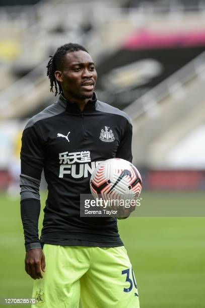 Christian Atsu of Newcastle United FC holds a ball in one hand during the Pre Season Friendly between Newcastle United and Stoke City at St James'...