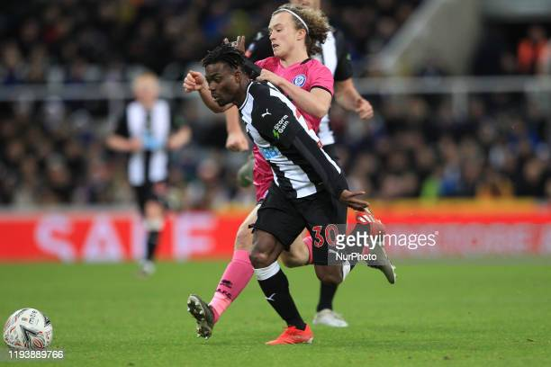 Christian Atsu of Newcastle United in action with Luke Matheson of Rochdale during the FA Cup match between Newcastle United and Rochdale at St...